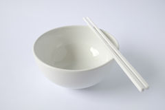 White bowl. White emply bowl with chopsticks Royalty Free Stock Images