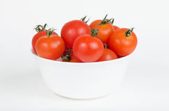 White bowl filled with cherry tomatoes Stock Photography
