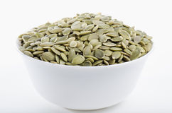 White bowl filled with dried pumpkin seeds Royalty Free Stock Image