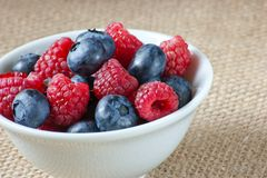 White bowl with fresh berries. Colorful fresh berries in white bowl Royalty Free Stock Photo