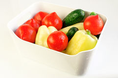 White bowl with fresh vegetables Royalty Free Stock Images