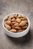 White bowl full of almonds Royalty Free Stock Photos