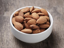 White bowl full of almonds Royalty Free Stock Photography