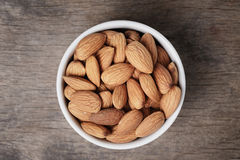 White bowl full of almonds Royalty Free Stock Image