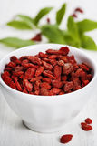 White bowl with goji berries Stock Images