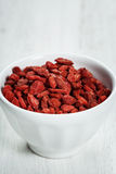 White bowl with goji berries Stock Photography