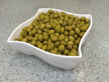 White bowl with green olives Royalty Free Stock Photos