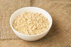White bowl. Healthy food. Oatmeal porridge. Light background. White bowl. Healthy tasty food. Oatmeal porridge. Light beighe background Stock Image