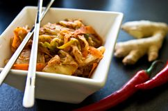 White bowl of Korean kimchi food with chopsticks Stock Photos