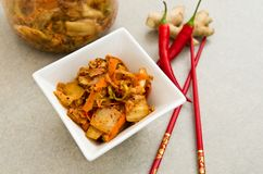 White bowl of Korean kimchi food with chopsticks Royalty Free Stock Photography