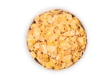 White bowl with natural organic granola cereal. Corn flakes on white.Top view Stock Image