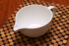 White bowl on plate. White empty soup bowl on wooden plate Royalty Free Stock Photography