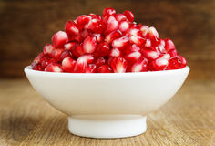 White bowl with pomegranate seeds Royalty Free Stock Images