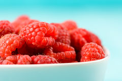 White Bowl Of Red Fresh Raspberries. Close Up Stock Image