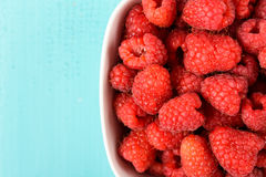 White Bowl Of Red Fresh Raspberries. Close Up Royalty Free Stock Image