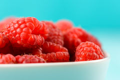 White Bowl Of Red Fresh Raspberries. Close Up Stock Photography