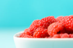 White Bowl Of Red Fresh Raspberries. Close Up Royalty Free Stock Photo