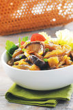 White bowl of sauteed mushroom with stir fried beef.  Stock Image
