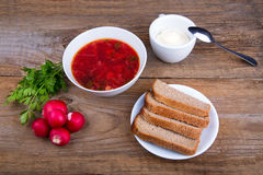 White Bowl of soup - borsch with parsley radish and bread Stock Photos
