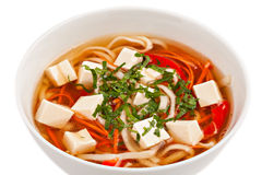 White bowl of soup with tofu. Royalty Free Stock Photos