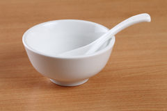 White bowl and spoon Royalty Free Stock Photography
