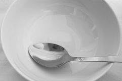 White Bowl and Spoon Royalty Free Stock Images