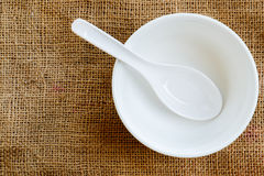 White bowl and spoon Royalty Free Stock Photo