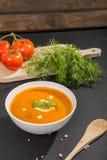 White bowl with squash soup Stock Photos