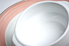 White bowl stacked on plate Royalty Free Stock Photo
