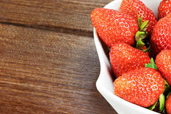 White bowl with strawberries closeup Royalty Free Stock Photography