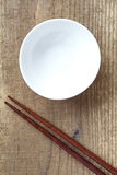 White bowl and wood chopsticks Stock Image