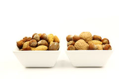 White bowls with assorted nuts Stock Photography