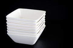 White Bowls on Black Royalty Free Stock Photos