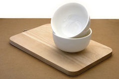 White bowls on a wood plate Royalty Free Stock Images