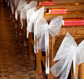 White bows in Catholic Church. Royalty Free Stock Photo