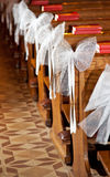 White bows in Catholic Church. Royalty Free Stock Image