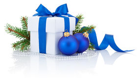 White box blue ribbon, pine tree branch and two hristmas balls Royalty Free Stock Photos