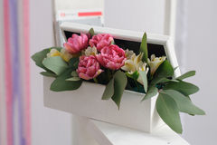 White box with decorative flowers Royalty Free Stock Photos