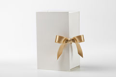 White box with golden bow Royalty Free Stock Image