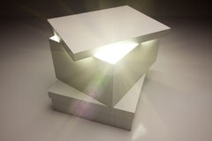 White Box with Lid Revealing Something Very Bright. On a Grey Background Stock Image