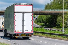 White box lorry truck on uk motorway in fast motion.  stock photos