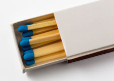 White box of matches with blue tips Royalty Free Stock Photo