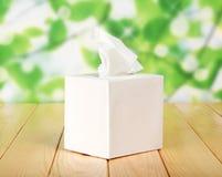 White box with napkins. Against green foliage Stock Photo