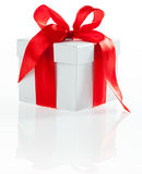 White box with red ribbon Royalty Free Stock Images
