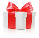 White box with Red satin ribbon and bow on the white background Royalty Free Stock Photos