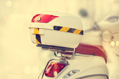 White box storage on back of motorcycle, Vintage color tone style Stock Photo