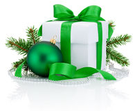 White box tied green ribbon bow, pine tree branch and christmas ball Stock Image