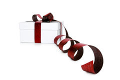 White box tied with a red satin ribbon bow Royalty Free Stock Images
