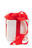 A white box tied with a red satin ribbon bow Stock Photography