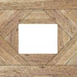 White box on wood background. Frame Stock Image